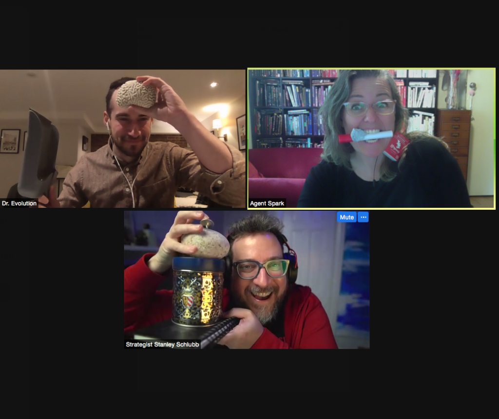 Screenshot of three players in zoom videochat holding up objects including coral, rocks, gold tins, matches, and markers.
